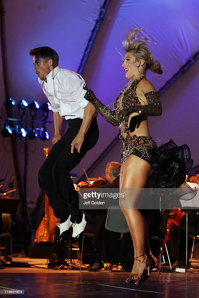 <a gi-track='captionPersonalityLinkClicked' href=/galleries/search?phrase=Derek+Hough&family=editorial&specificpeople=4532214 ng-click='$event.stopPropagation()'>Derek Hough</a> dances with partner Emma Slater to Glenn Miller's 'In The Mood' during the California Philharmonic Festival on the Green at Santa Anita Race Track on July 27, 2013 in Arcadia, California.