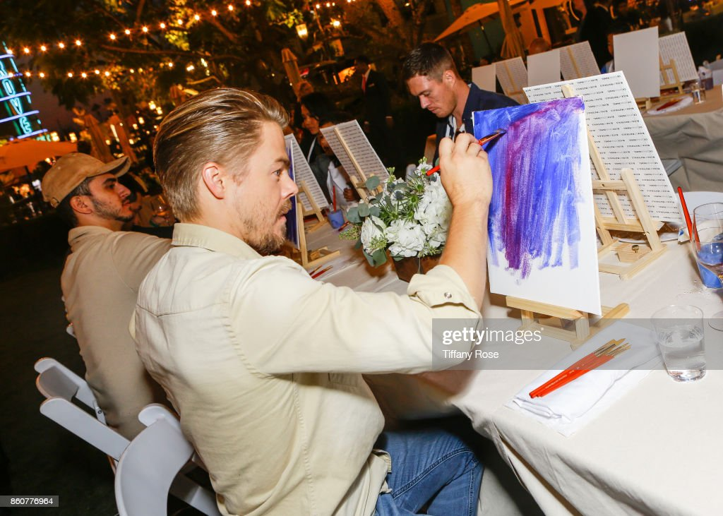 Derek Hough paints at the Paint & Sip & Help event to Benefit Children's Hospital Los Angeles hosted by The Grove on October 12, 2017 in Los Angeles, California.