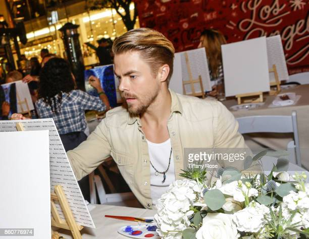 Derek Hough paints at the Paint Sip Help event to Benefit Children's Hospital Los Angeles hosted by The Grove on October 12 2017 in Los Angeles...