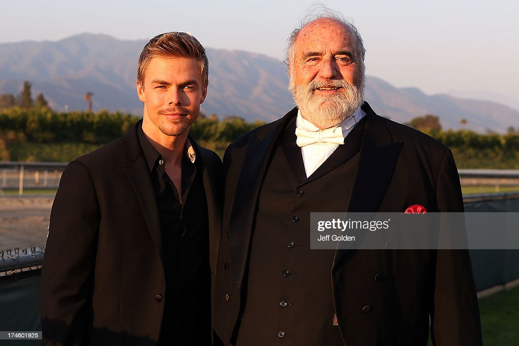 <a gi-track='captionPersonalityLinkClicked' href=/galleries/search?phrase=Derek+Hough&family=editorial&specificpeople=4532214 ng-click='$event.stopPropagation()'>Derek Hough</a> poses backstage with Maestro Victor Vener before the California Philharmonic Festival on the Green at Santa Anita Race Track on July 27, 2013 in Arcadia, California.