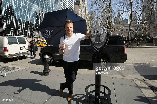 "Derek Hough poses with a Hilton Hotels Resorts ""StoryFinder"" in New York City inspiring people to use the power of visualization to realize their..."