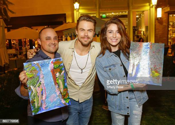 Derek Hough poses with fans at the Paint Sip Help event with Derek Hough Mother Marriann Nelson to Benefit Children's Hospital Los Angeles at The...