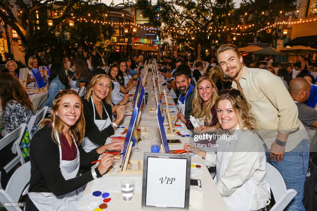Derek Hough poses with guests at the Paint & Sip & Help event to Benefit Children's Hospital Los Angeles hosted at The Grove on October 12, 2017 in Los Angeles, California.