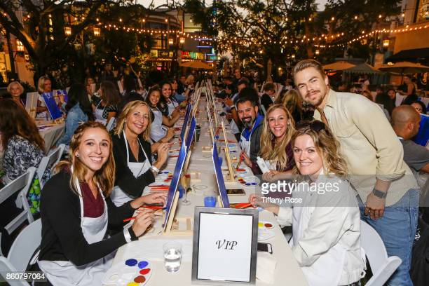 Derek Hough poses with guests at the Paint Sip Help event to Benefit Children's Hospital Los Angeles hosted at The Grove on October 12 2017 in Los...