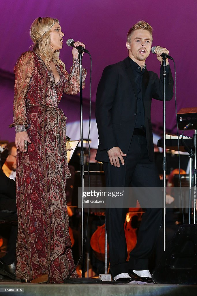 Derek Hough sings 'Falling Slowly' with BC Jean during the California Philharmonic Festival on the Green at Santa Anita Race Track on July 27, 2013 in Arcadia, California.