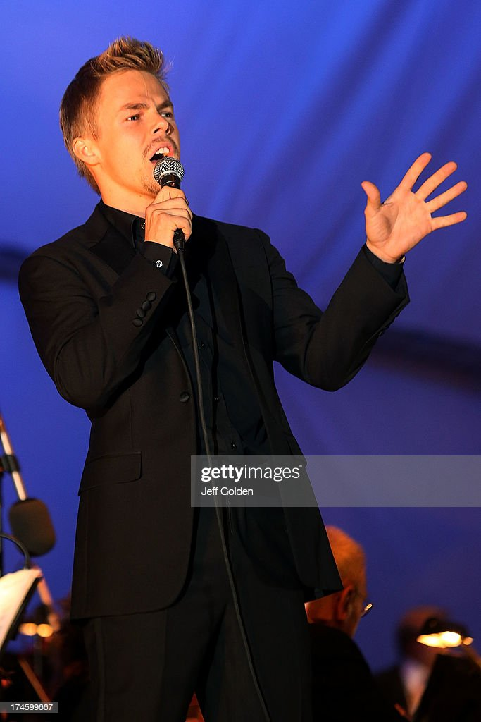 <a gi-track='captionPersonalityLinkClicked' href=/galleries/search?phrase=Derek+Hough&family=editorial&specificpeople=4532214 ng-click='$event.stopPropagation()'>Derek Hough</a> sings 'Feeling Good' during the California Philharmonic Festival on the Green at Santa Anita Race Track on July 27, 2013 in Arcadia, California.