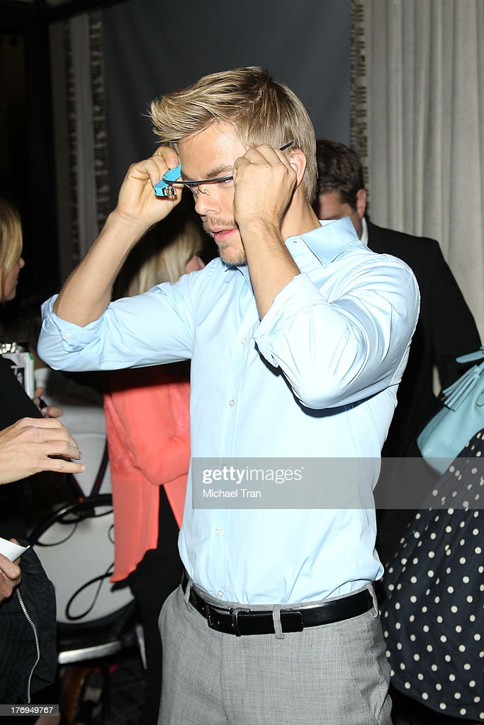 <a gi-track='captionPersonalityLinkClicked' href=/galleries/search?phrase=Derek+Hough&family=editorial&specificpeople=4532214 ng-click='$event.stopPropagation()'>Derek Hough</a> trys on Google glasses at the Academy of Television Arts & Sciences' Performers Peer Group cocktail reception to celebrate The 65th Primetime Emmy Awards held at Sheraton Universal on August 19, 2013 in Universal City, California.