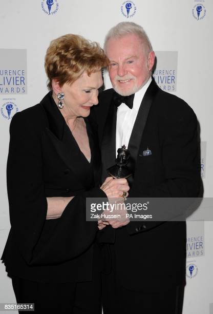 Derek Jacobi wins the Best Actor Award presented by Sian Phillips during the Laurence Olivier Awards at the Grosvenor Hotel in central London