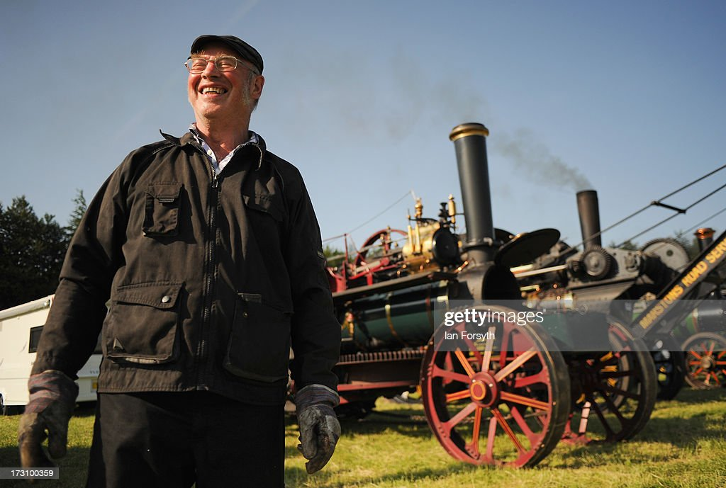 Derek James or 'Mr Fix It' as he is also known from Castle Howard poses next to his engine at the steam rally at Duncombe Park on July 7, 2013 in Helmsley, England. The popular steam rally takes place in the magnificent surroundings of the park over the first weekend in July each year and brings together traction engines, working displays, vintage tractors, commercial and military vehicles and vintage cars.