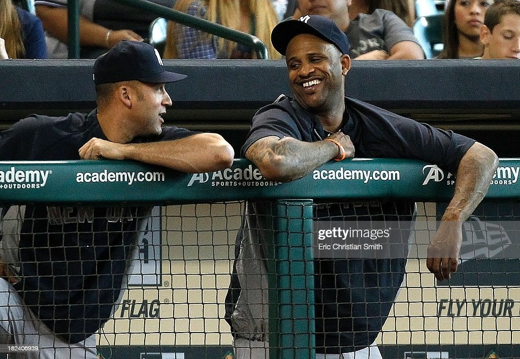<a gi-track='captionPersonalityLinkClicked' href=/galleries/search?phrase=Derek+Jeter&family=editorial&specificpeople=167125 ng-click='$event.stopPropagation()'>Derek Jeter</a> (L), #2 of the New York Yankees talks in the dugout with CC Sabathia #52 during the fifth inning against the Houston Astros on September 29, 2013 at Minute Maid Park in Houston, TX.