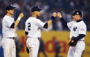 Derek Jeter Aaron Boone and Karim Garcia of the New York Yankees celebrate after defeating the Boston Red Sox 62 in game 2 of the American League...