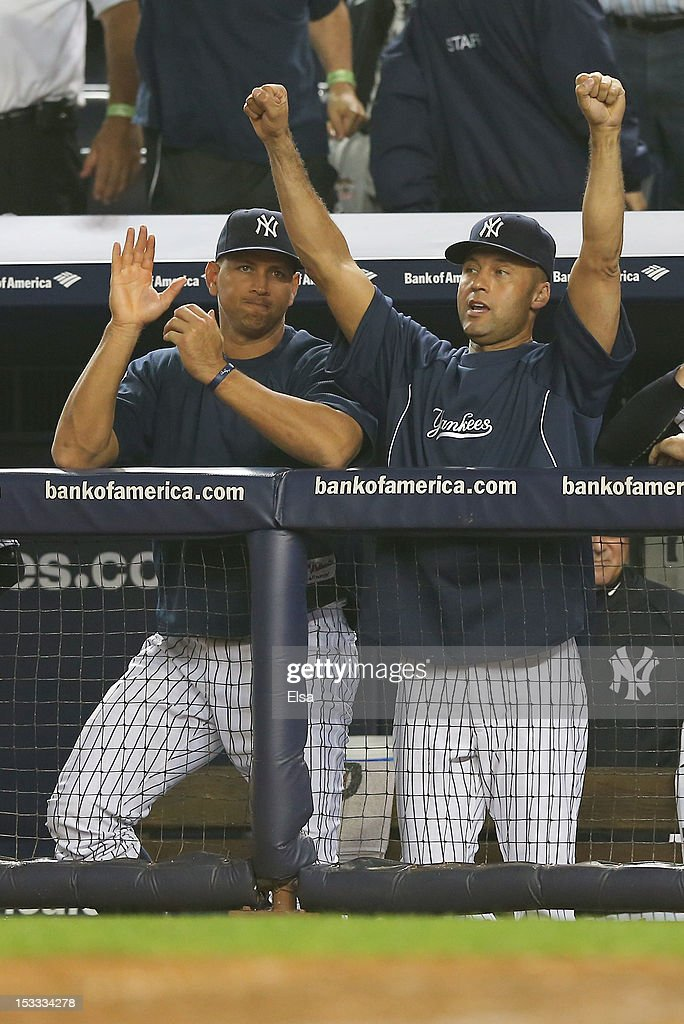 Derek Jeter #2 and Alex Rodriguez #13 of the New York Yankees celebrate the win over the Boston Red Sox on October 3, 2012 at Yankee Stadium in the Bronx borough of New York City. With the win, the New York Yankees clinch the A.L. East Division title.