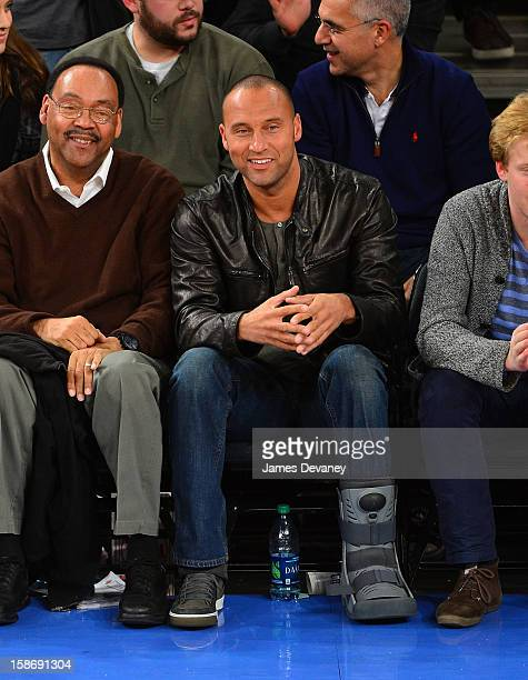 Derek Jeter and father Sanderson Jeter attend the Minnesota Timberwolves vs New York Knicks game at Madison Square Garden on December 23 2012 in New...