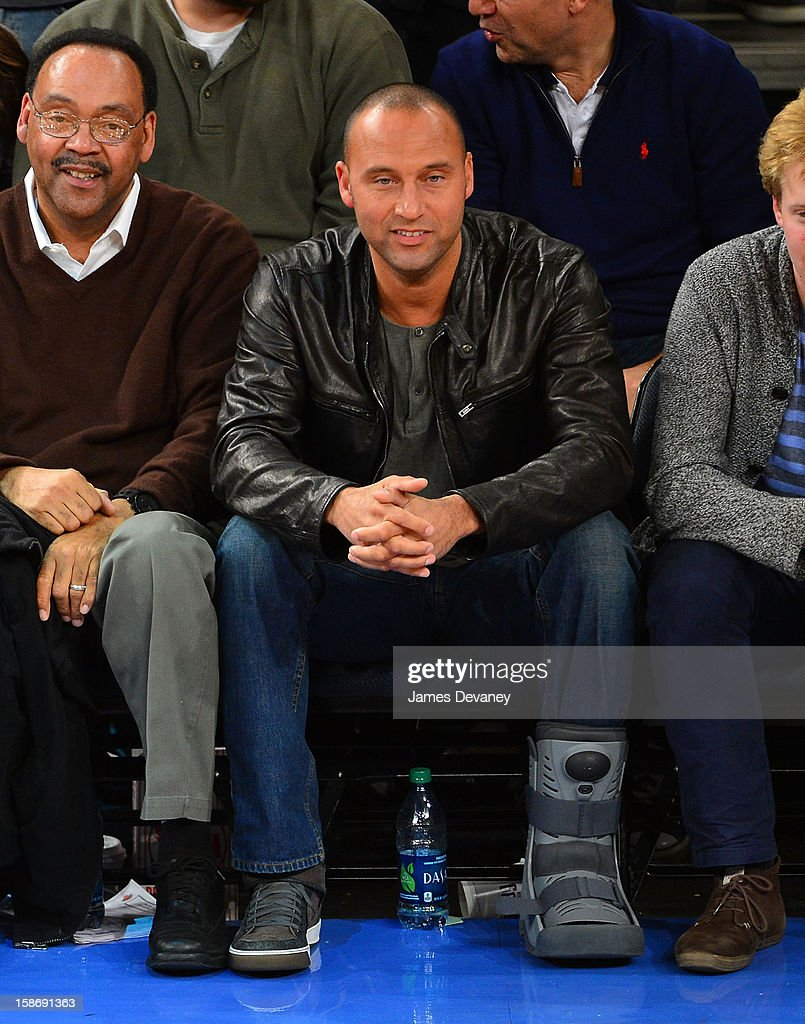 Derek Jeter and father Sanderson Jeter (L) attend the Minnesota Timberwolves vs New York Knicks game at Madison Square Garden on December 23, 2012 in New York City.