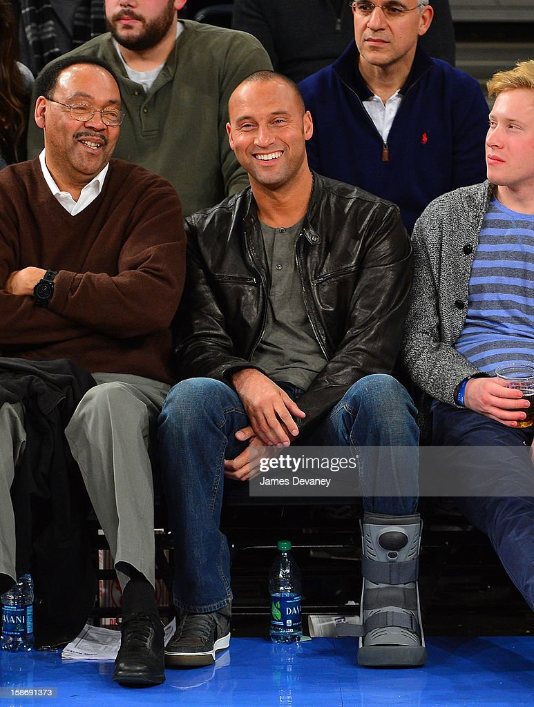 <a gi-track='captionPersonalityLinkClicked' href=/galleries/search?phrase=Derek+Jeter&family=editorial&specificpeople=167125 ng-click='$event.stopPropagation()'>Derek Jeter</a> and father Sanderson Jeter (L) attend the Minnesota Timberwolves vs New York Knicks game at Madison Square Garden on December 23, 2012 in New York City.