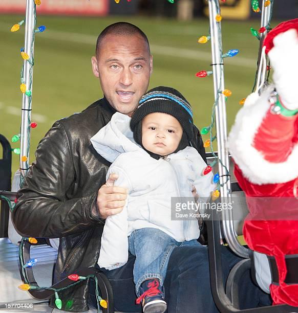 Derek Jeter and his nephew Jalen Jeter attends Derek Jeter's 2012 Turn 2 Holiday Express at Yankee Stadium on December 5 2012 in New York City