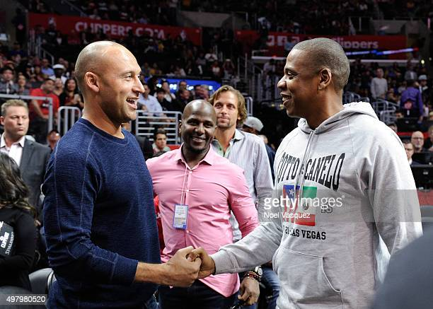 Derek Jeter and Jay Z attend a basketball game between the Golden State Warriors and the Los Angeles Clippers at Staples Center on November 19 2015...