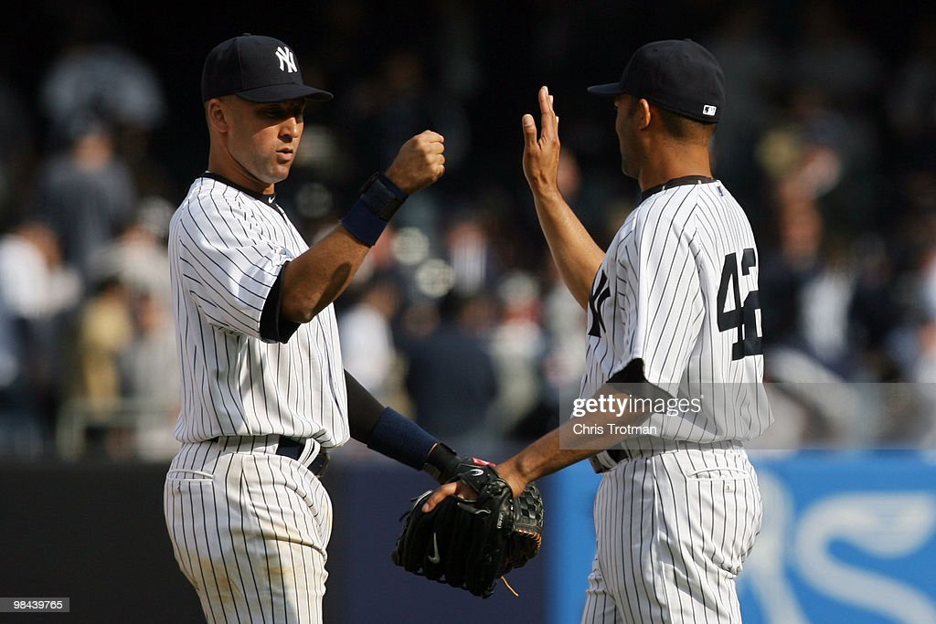 Derek Jeter #2 and Mariano Rivera #42 of the New York Yankees celebrate after defeating the Los Angeles Angels of Anaheim during the Yankees home opener at Yankee Stadium on April 13, 2010 in the Bronx borough of New York City.