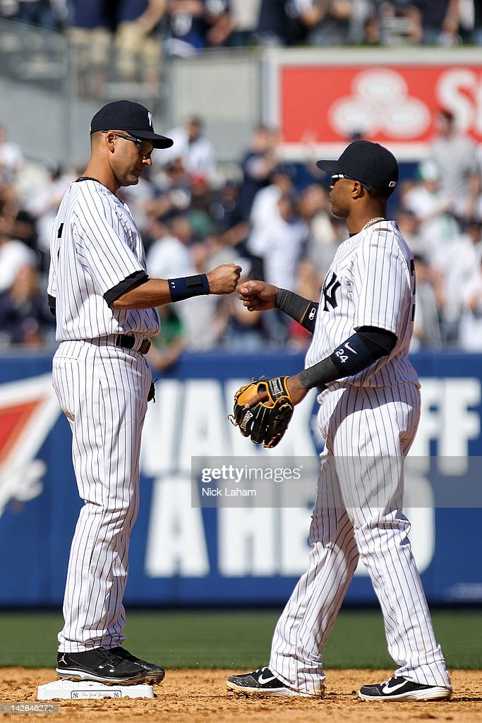 <a gi-track='captionPersonalityLinkClicked' href=/galleries/search?phrase=Derek+Jeter&family=editorial&specificpeople=167125 ng-click='$event.stopPropagation()'>Derek Jeter</a> #2 and <a gi-track='captionPersonalityLinkClicked' href=/galleries/search?phrase=Robinson+Cano&family=editorial&specificpeople=538362 ng-click='$event.stopPropagation()'>Robinson Cano</a> #24 of the New York Yankees celebrate after defeating the Los Angeles Angels by a score of 5-0 during the home opener at Yankee Stadium on April 13, 2012 in the Bronx borough of New York City.