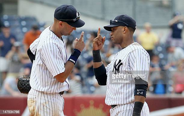 Derek Jeter and Robinson Cano of the New York Yankees celebrate after defeating the Chicago White Sox at Yankee Stadium on July 1 2012 in the Bronx...