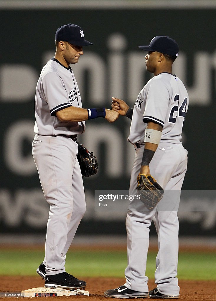 <a gi-track='captionPersonalityLinkClicked' href=/galleries/search?phrase=Derek+Jeter&family=editorial&specificpeople=167125 ng-click='$event.stopPropagation()'>Derek Jeter</a> #2 and <a gi-track='captionPersonalityLinkClicked' href=/galleries/search?phrase=Robinson+Cano&family=editorial&specificpeople=538362 ng-click='$event.stopPropagation()'>Robinson Cano</a> #24 of the New York Yankees celebrate the win over the Boston Red Sox on August 30, 2011 at Fenway Park in Boston, Massachusetts. The New York Yankees defeated the Boston Red Sox 5-2.