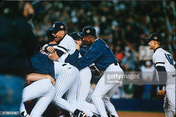 Derek Jeter and the New York Yankees celebrate after winning game six of the 1996 World Series at Yankee Stadium on October 26 1996 in the Bronx...
