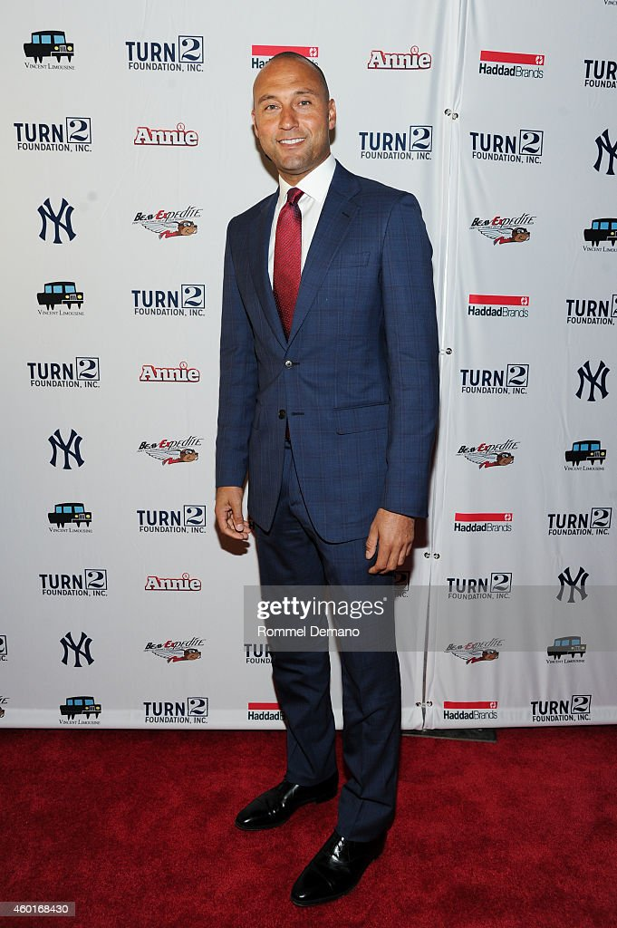 <a gi-track='captionPersonalityLinkClicked' href=/galleries/search?phrase=Derek+Jeter&family=editorial&specificpeople=167125 ng-click='$event.stopPropagation()'>Derek Jeter</a> attends the <a gi-track='captionPersonalityLinkClicked' href=/galleries/search?phrase=Derek+Jeter&family=editorial&specificpeople=167125 ng-click='$event.stopPropagation()'>Derek Jeter</a>'s Annual Turn 2 Holiday Express Event at AMC Lincoln Square Theater on December 8, 2014 in New York City.