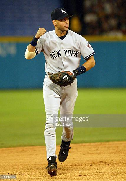 Derek Jeter celebrates as the New York Yankees get out of the sixth inning against the Florida Marlins in Game 3 of the Major League Baseball World...