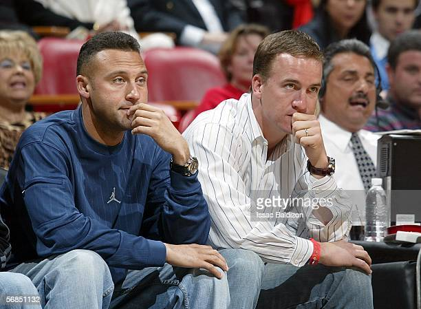 Derek Jeter of the New York Yankees and Peyton Manning of the Indianapolis Colts watch the Orlando Magic play the Miami Heat on February 14 2006 at...