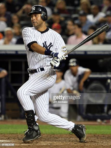 Derek Jeter of the New York Yankees bats against the Minnesota Twins in Game Two of the ALDS during the 2009 MLB Playoffs at Yankee Stadium on...