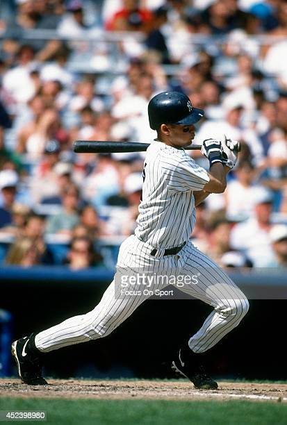 Derek Jeter of the New York Yankees bats during an Major League Baseball game circa 1996 at Yankee Stadium in the Bronx borough of New York City...