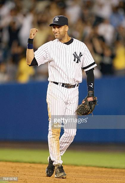 Derek Jeter of the New York Yankees celebrates a 51 win against the Minnesota Twins after their game on July 2 2007 at Yankee Stadium in The Bronx...
