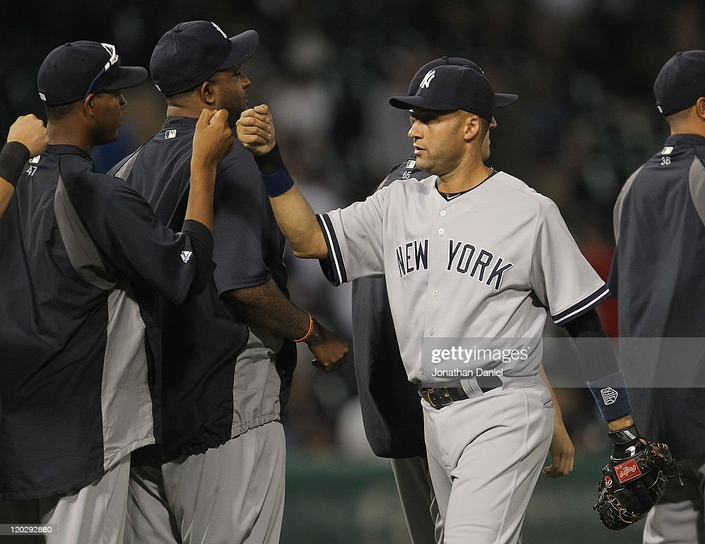 Derek Jeter #2 of the New York Yankees celebrates a win with teammates over the Chicago White Sox at U.S. Cellular Field on August 3, 2011 in Chicago, Illinois. The Yankees defeated the White Sox 18-7.