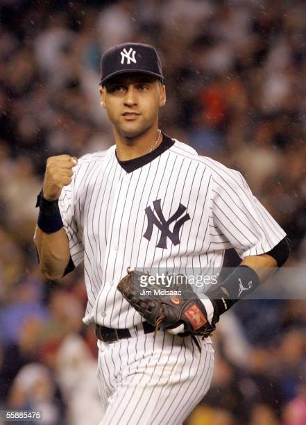 Derek Jeter of the New York Yankees celebrates after a double play against the Los Angeles Angels of Anaheim to end the fourth inning during Game...