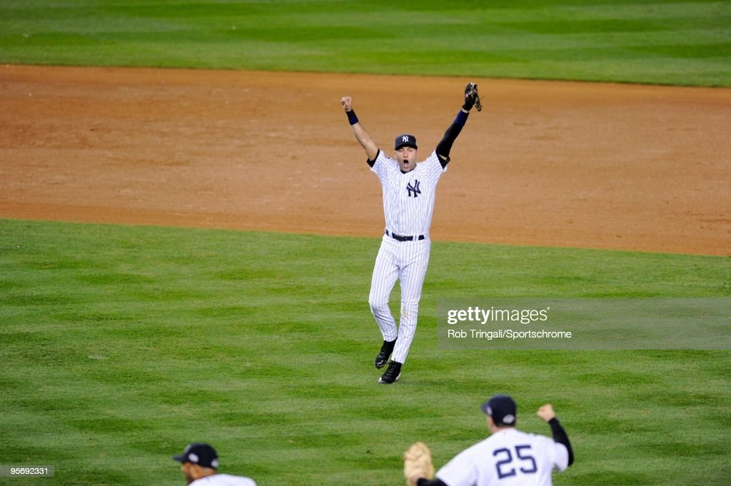 <a gi-track='captionPersonalityLinkClicked' href=/galleries/search?phrase=Derek+Jeter&family=editorial&specificpeople=167125 ng-click='$event.stopPropagation()'>Derek Jeter</a> #2 of the New York Yankees celebrates after defeating the Philadelphia Phillies slides in during Game Six of the 2009 MLB World Series at Yankee Stadium on November 4, 2009 in the Bronx borough of New York City.
