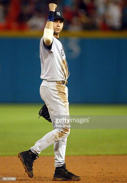 Derek Jeter of the New York Yankees celebrates the final out against the Florida Marlins during Game 3 of the Major League Baseball World Series...