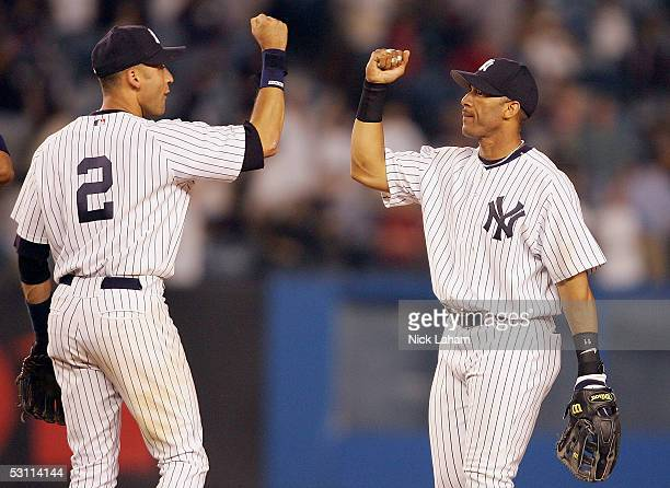 Derek Jeter of the New York Yankees celebrates the win with Gary Sheffield against the Tampa Bay Devil Rays on June 21 2005 at Yankee Stadium in the...