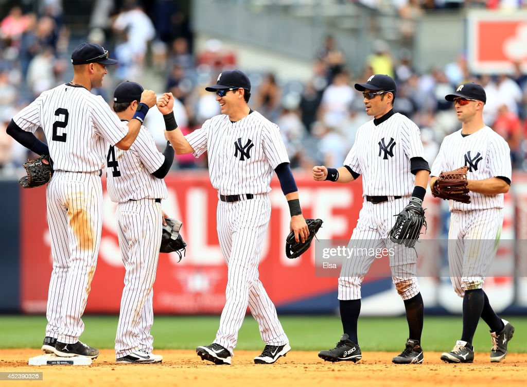 Derek Jeter of the New York Yankees celebrates the win with teammates Jacoby Ellsbury Brian RobertsIchiro Suzuki and Brett Gardner after the win over...