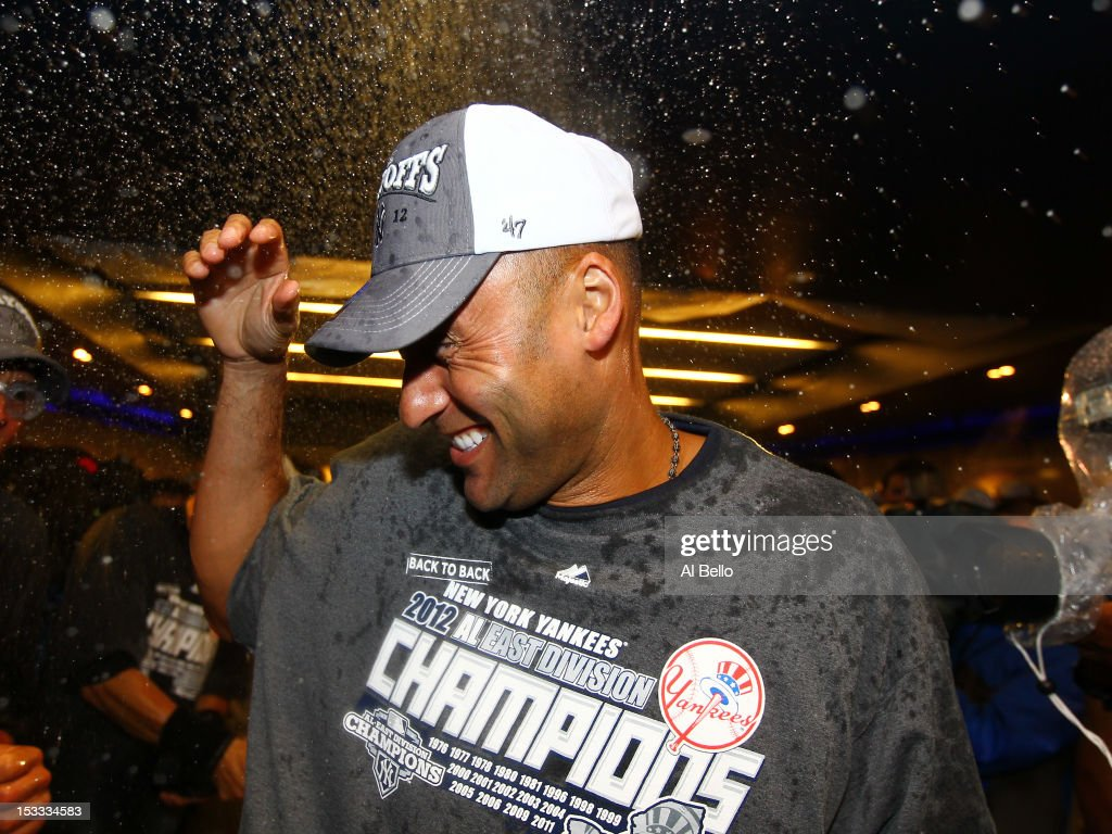 Derek Jeter #2 of the New York Yankees celebrates winning the American League East Division Championship after their 14-2 win against the Boston Red Sox on October 3, 2012 at Yankee Stadium in the Bronx borough of New York City.