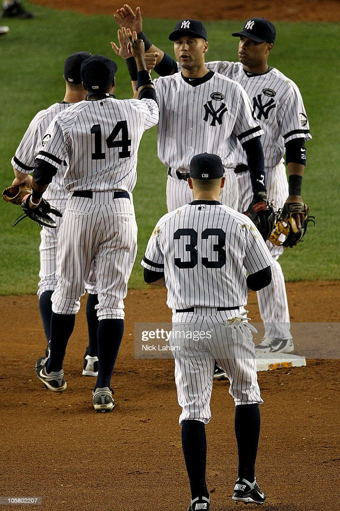 Derek Jeter #2 of the New York Yankees celebrates with his teammates after the Yankees won 7-2 against the Texas Rangers in Game Five of the ALCS during the 2010 MLB Playoffs at Yankee Stadium on October 20, 2010 in the Bronx borough of New York City.