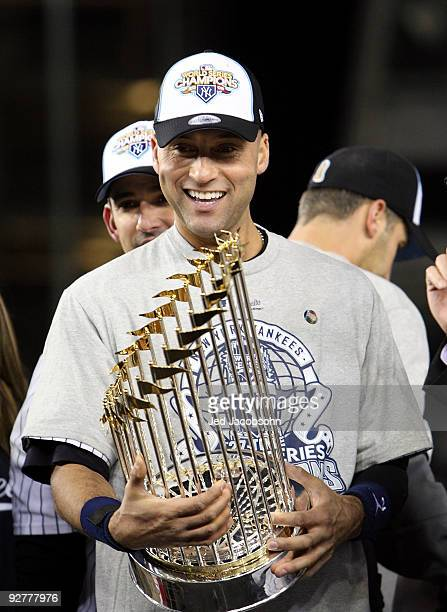 Derek Jeter of the New York Yankees celebrates with the trophy after their 73 win against the Philadelphia Phillies in Game Six of the 2009 MLB World...