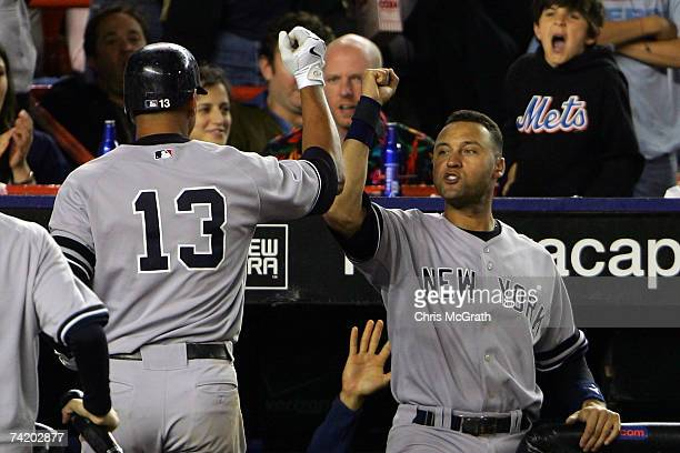 Derek Jeter of the New York Yankees congratulates Alex Rodriguez after his solo home run in the seventh inning against the New York Mets on May 20...