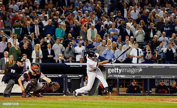Derek Jeter of the New York Yankees connects on a seventh inning infield base hit against the Baltimore Orioles at Yankee Stadium on September 23...