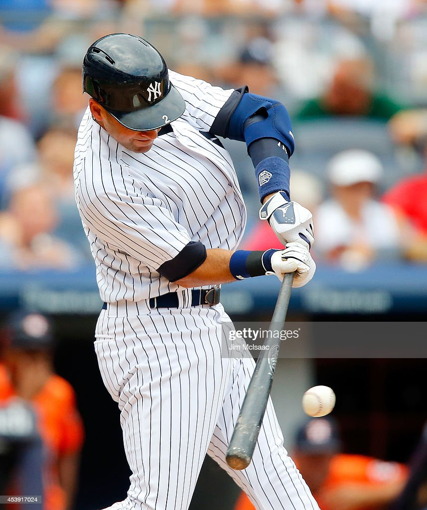 Derek Jeter #2 of the New York Yankees connects on a sixth inning base hit against the Houston Astros at Yankee Stadium on August 21, 2014 in the Bronx borough of New York City.