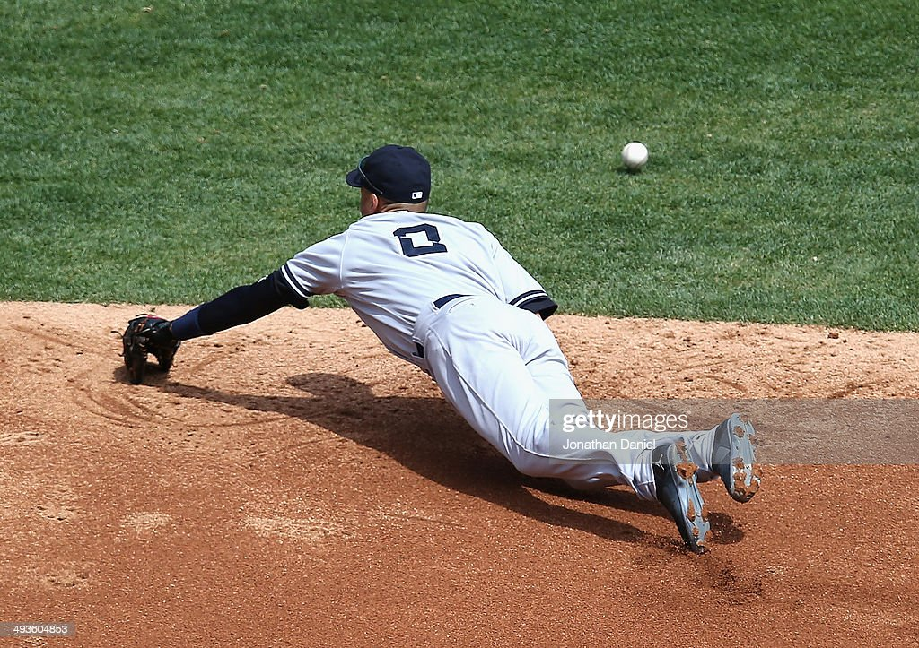 Derek Jeter #2 of the New York Yankees dives but misses a ball hit by Marcus Semien of the Chicago White Sox in the 2nd inning at U.S. Cellular Field on May 24, 2014 in Chicago, Illinois.
