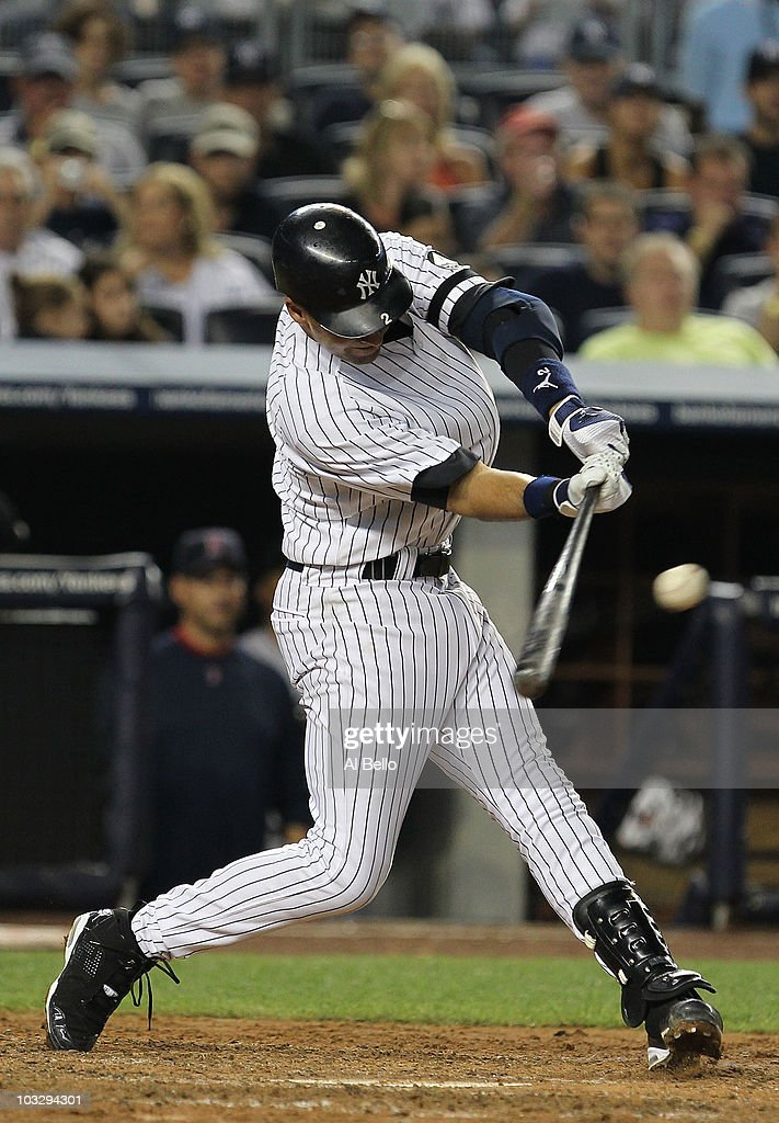 <a gi-track='captionPersonalityLinkClicked' href=/galleries/search?phrase=Derek+Jeter&family=editorial&specificpeople=167125 ng-click='$event.stopPropagation()'>Derek Jeter</a> #2 of the New York Yankees doubles in two runs against the Boston Red Sox in the fifth inning during their game on August 8, 2010 at Yankee Stadium in the Bronx borough of New York City.
