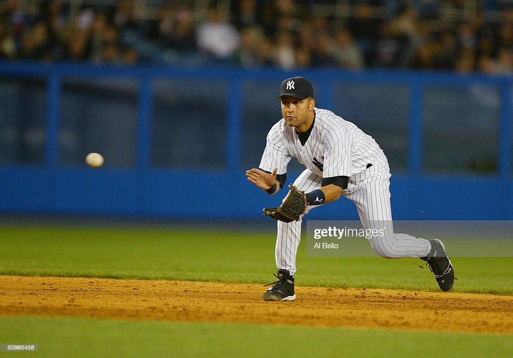 Derek Jeter of the New York Yankees fields a ground ball during the game against the Oakland A's on April 27 2004 at Yankee Stadium in the Bronx New...