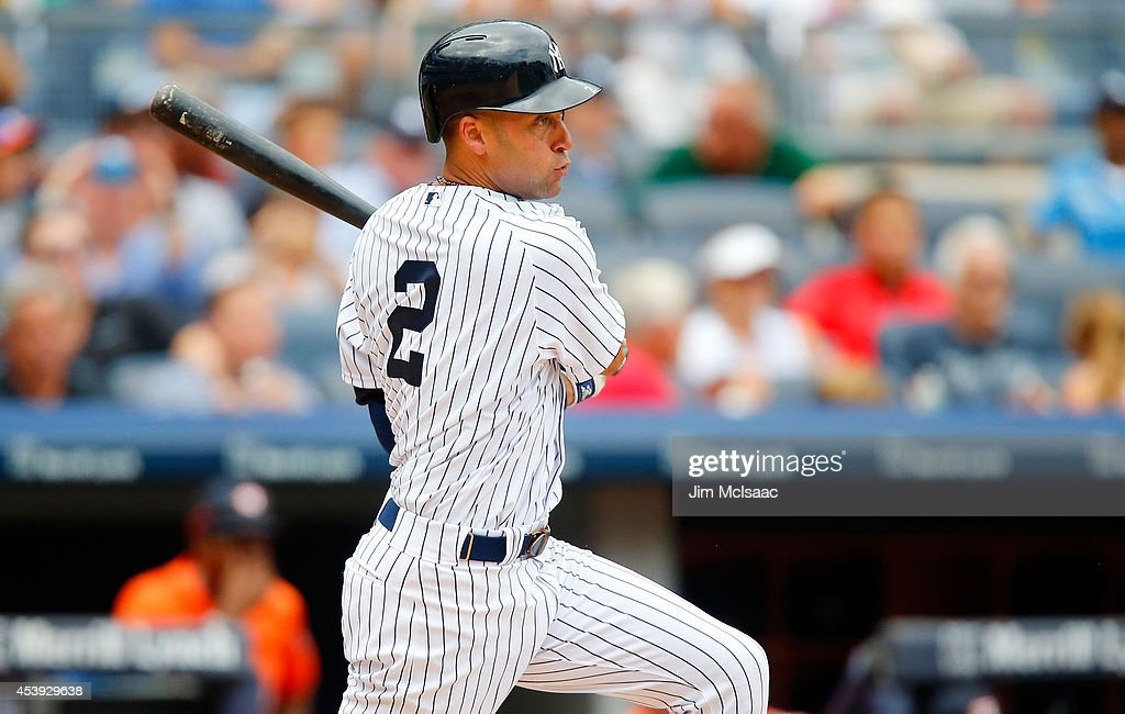 Derek Jeter #2 of the New York Yankees follows through on a sixth inning base hit against the Houston Astros at Yankee Stadium on August 21, 2014 in the Bronx borough of New York City.