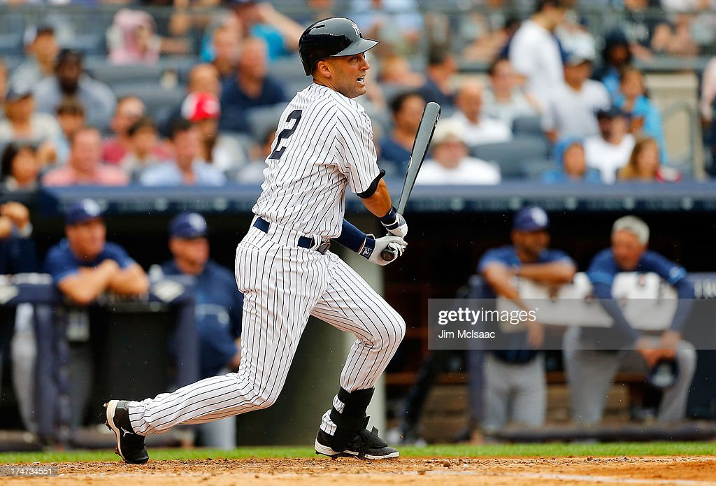 <a gi-track='captionPersonalityLinkClicked' href=/galleries/search?phrase=Derek+Jeter&family=editorial&specificpeople=167125 ng-click='$event.stopPropagation()'>Derek Jeter</a> #2 of the New York Yankees follows through on a third inning base hit against the Tampa Bay Rays at Yankee Stadium on July 28, 2013 in the Bronx borough of New York City.