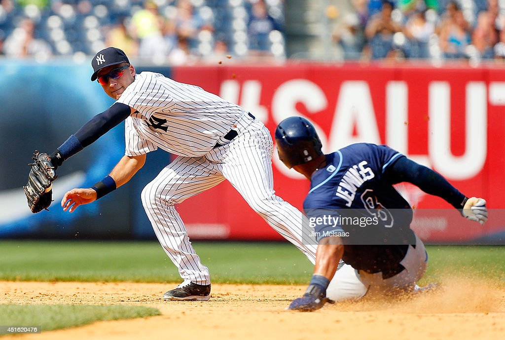 <a gi-track='captionPersonalityLinkClicked' href=/galleries/search?phrase=Derek+Jeter&family=editorial&specificpeople=167125 ng-click='$event.stopPropagation()'>Derek Jeter</a> #2 of the New York Yankees forces out <a gi-track='captionPersonalityLinkClicked' href=/galleries/search?phrase=Desmond+Jennings&family=editorial&specificpeople=5974085 ng-click='$event.stopPropagation()'>Desmond Jennings</a> #8 of the Tampa Bay Rays at second base during the ninth inning at Yankee Stadium on July 2, 2014 in the Bronx borough of New York City.